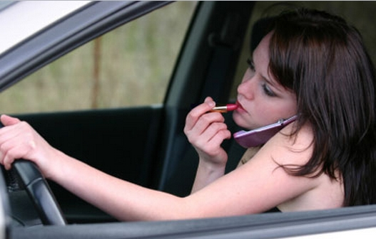 driving and applying makeup
